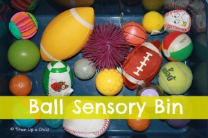 Sensory bin with lots of shapes and colors of balls